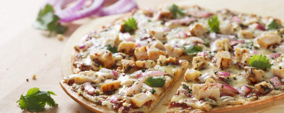 barbecue chicken pizza on table